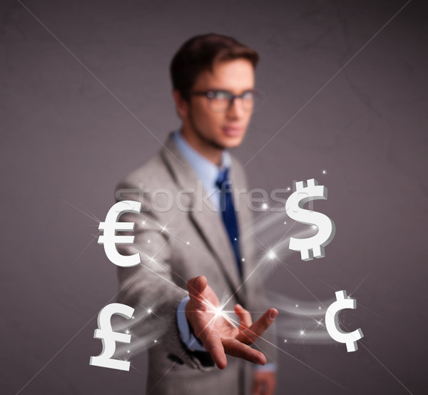 Attractive man throwing currency icons Stock photo © ra2studio
