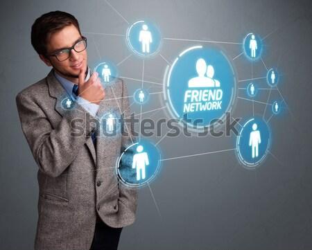 Bell'uomo guardando moderno social network bello giovane Foto d'archivio © ra2studio