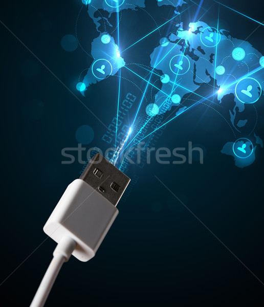 Social network icons coming out of electric cable Stock photo © ra2studio
