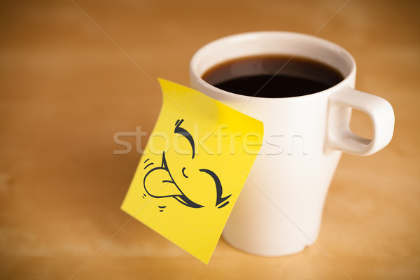 Post-it note with smiley face sticked on cup Stock photo © ra2studio