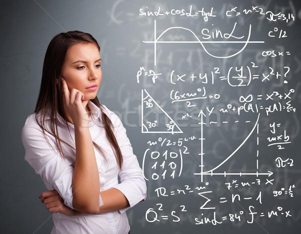Piękna uczennica myślenia kompleks matematyczny znaki Zdjęcia stock © ra2studio