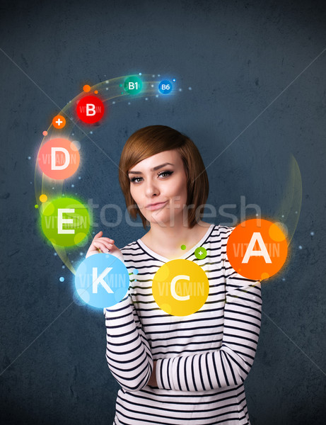 Jonge vrouw denken vitaminen rond hoofd nadenkend Stockfoto © ra2studio