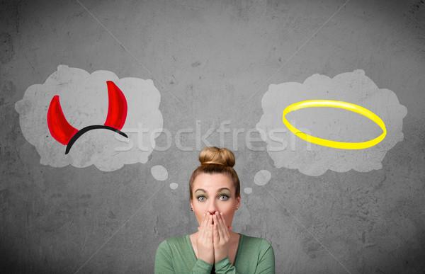 Woman choosing between good and bad Stock photo © ra2studio