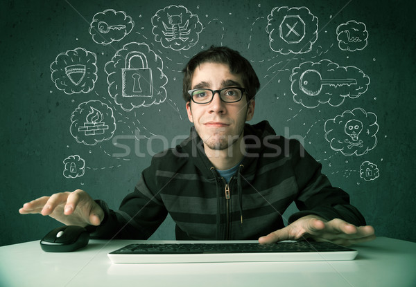 Young nerd hacker with virus and hacking thoughts Stock photo © ra2studio