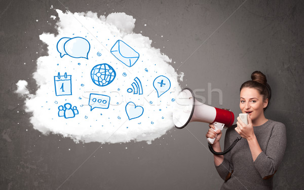 Woman shouting into loudspeaker and modern blue icons and symbol Stock photo © ra2studio