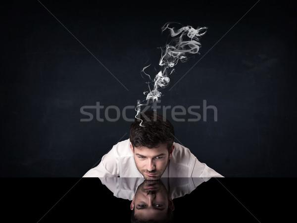Deprimido empresario fumar cabeza jóvenes sesión Foto stock © ra2studio