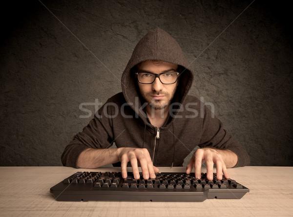 Bilgisayar geek yazarak klavye genç hacker Stok fotoğraf © ra2studio