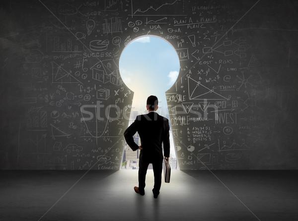 Homme d'affaires regarder serrure lumineuses cityscape affaires Photo stock © ra2studio