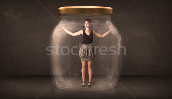 Businesswoman captured in a glass jar concept Stock photo © ra2studio