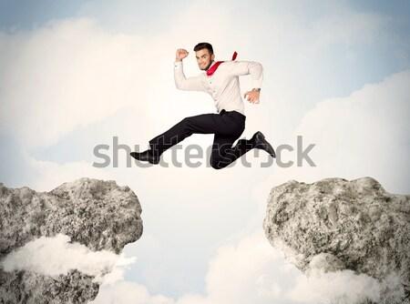 Feliz homem de negócios saltando penhasco negócio homem Foto stock © ra2studio