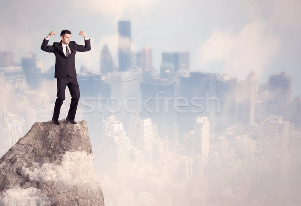 Winner urban businessman on top of stone  Stock photo © ra2studio