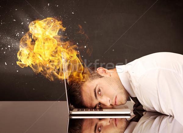 Business testa brucia depresso imprenditore Foto d'archivio © ra2studio