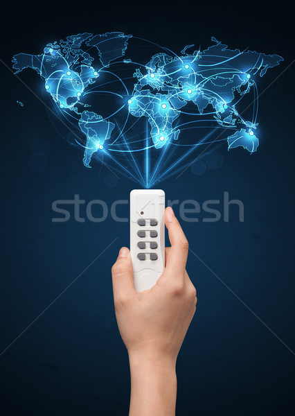 Hand with remote control, social media concept Stock photo © ra2studio