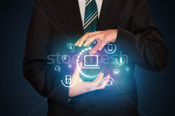 Halten digitalen Medien Symbole Geschäftsmann Hände Stock foto © ra2studio