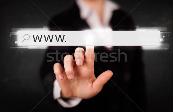 Genç işkadını dokunmak web tarayıcı adres Stok fotoğraf © ra2studio