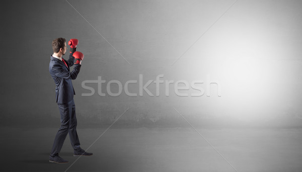 Businessman fighting in an empty space Stock photo © ra2studio