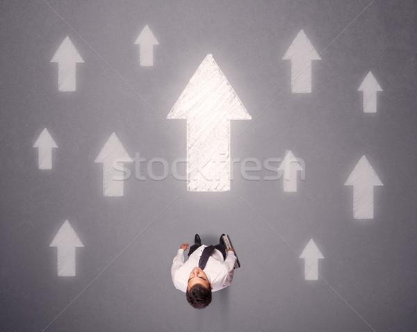 Işadamı karar genç beyaz oklar Stok fotoğraf © ra2studio