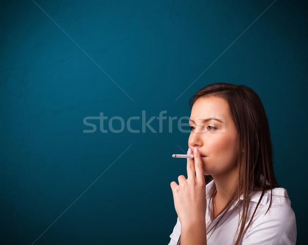 Mujer hermosa fumar cigarrillo espacio de la copia hermosa Foto stock © ra2studio