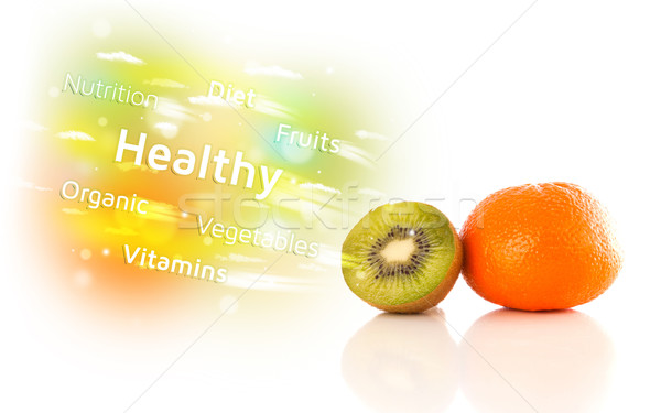 Colorful juicy fruits with healthy text and signs  Stock photo © ra2studio