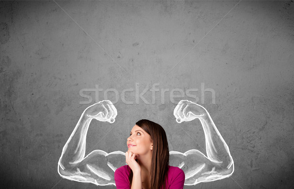 Young woman with strong muscled arms Stock photo © ra2studio