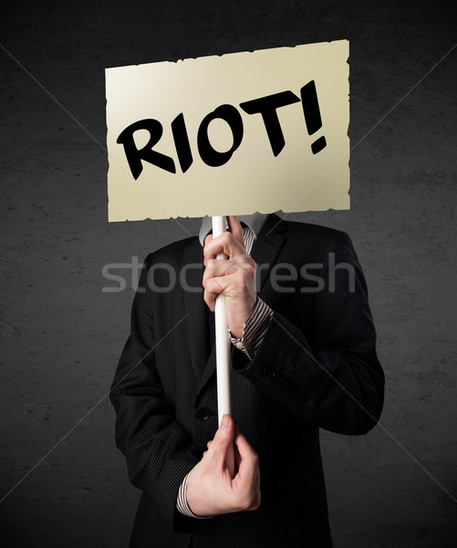 Businessman holding a protest sign Stock photo © ra2studio