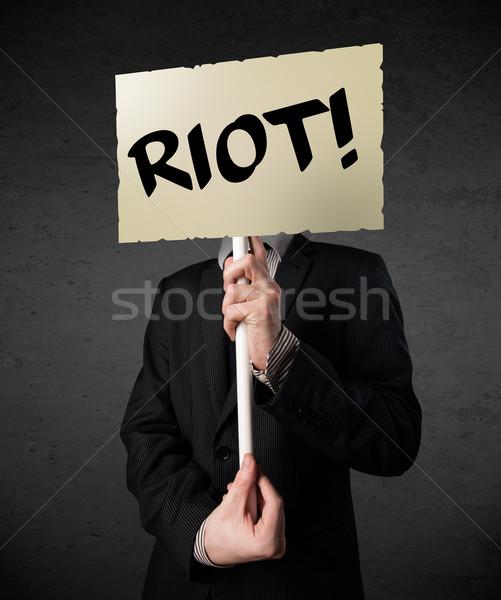 üzletember tart tiltakozás felirat demonstráció tábla Stock fotó © ra2studio