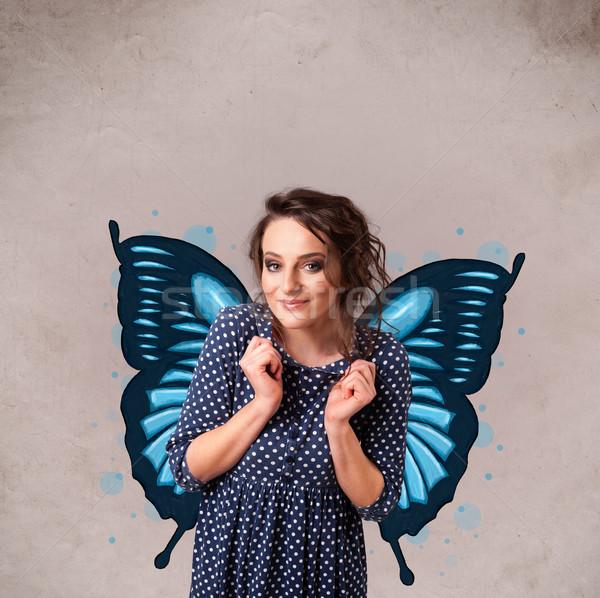 Genç kız kelebek mavi örnek geri sevimli Stok fotoğraf © ra2studio