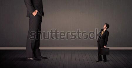 Kicsi óriás főnök lábak üzlet háttér Stock fotó © ra2studio