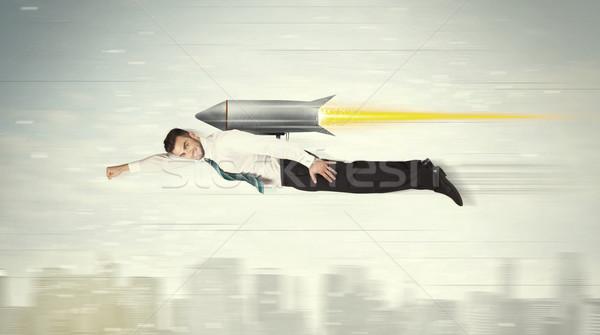 Homem de negócios voador jato empacotar foguete Foto stock © ra2studio