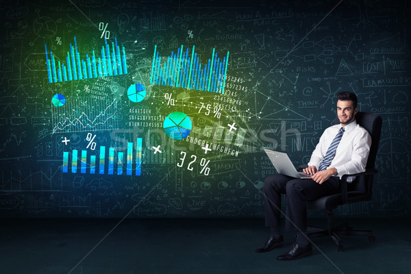 Businessman in office chair with laptop in hand and high tech gr Stock photo © ra2studio