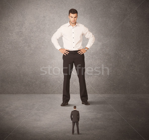 Büyük iş adamı bakıyor küçük işçi çalışmak Stok fotoğraf © ra2studio