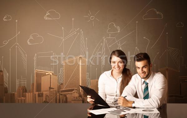Działalności para budynków posiedzenia czarny tabeli Zdjęcia stock © ra2studio