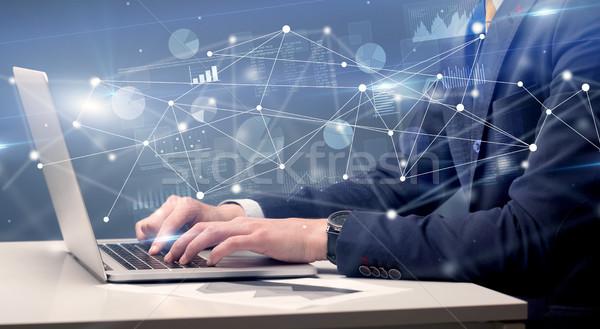 Kéz gépel laptop jelentés táblázatok körül Stock fotó © ra2studio