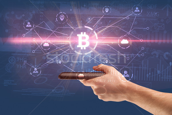 Hand using phone with bitcoin link network and online concept Stock photo © ra2studio