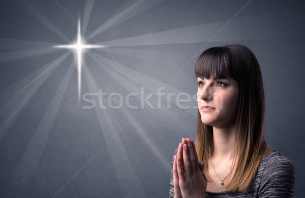 молиться девушки серый крест Сток-фото © ra2studio