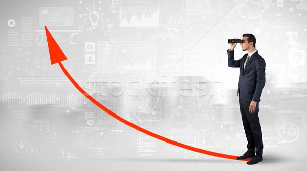 Człowiek patrząc naprzód wzrost wykres biznesmen Zdjęcia stock © ra2studio