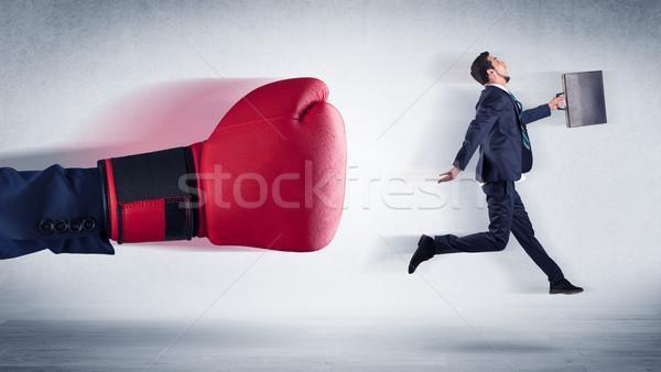 Big hand boxing little businessman Stock photo © ra2studio