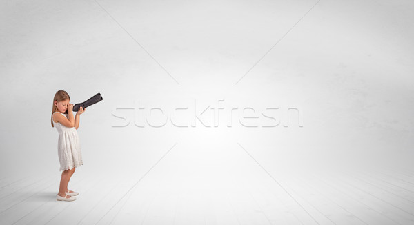 Kid looking through spyglass to an empty space Stock photo © ra2studio