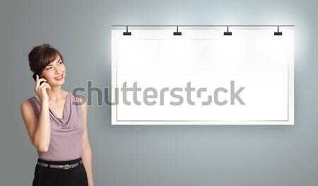 Gyönyörű fiatal nő áll modern copy space készít Stock fotó © ra2studio