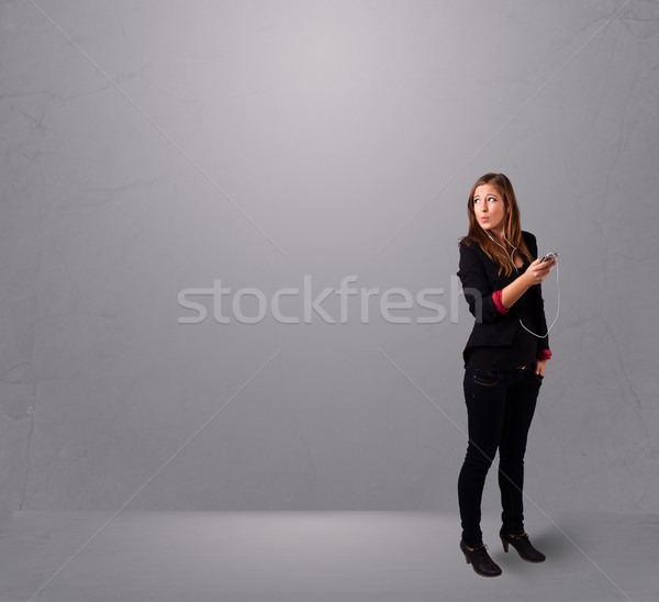 young lady singing and listening to music with copy space Stock photo © ra2studio