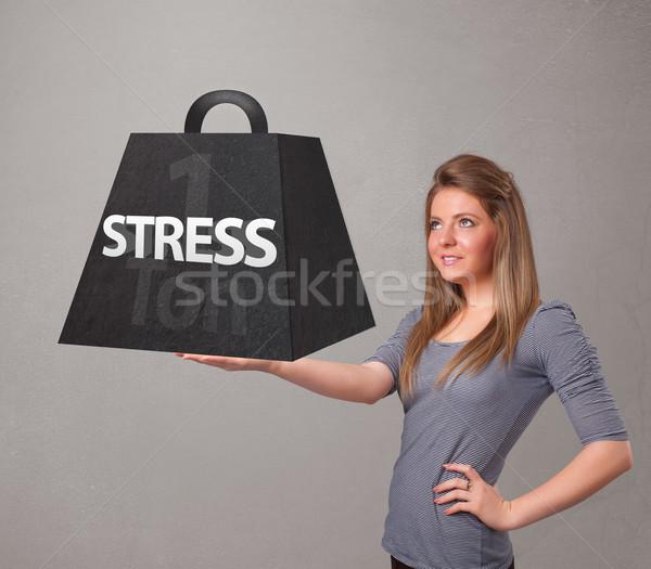 Genç kadın bir stres ağırlık çekici Stok fotoğraf © ra2studio