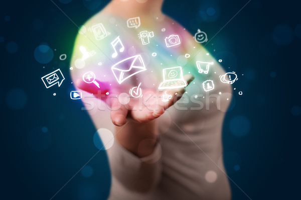 Young woman presenting colorful social media icons Stock photo © ra2studio
