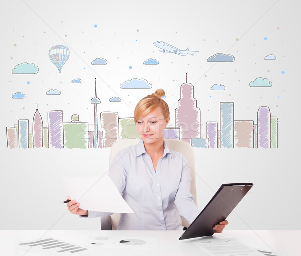 Pretty businesswoman with colorful city sky-scape background Stock photo © ra2studio