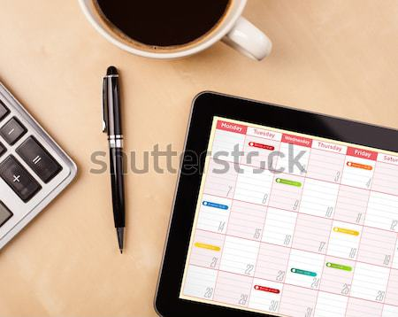 Travail calendrier tasse café Photo stock © ra2studio