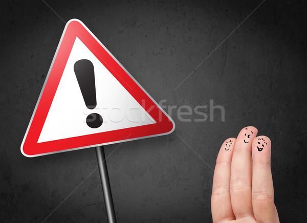 Szczęśliwy wesoły palce patrząc trójkąt Zdjęcia stock © ra2studio