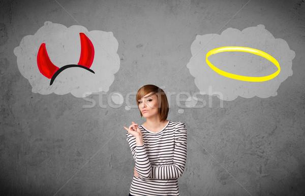 Stock photo: Woman choosing between good and bad
