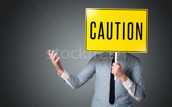 Biznesmen ostrożność podpisania stałego żółty Zdjęcia stock © ra2studio