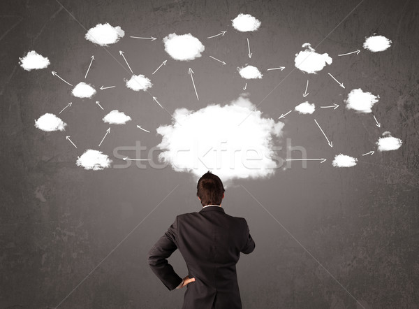 Businessman sitting with cloud technology above his head Stock photo © ra2studio