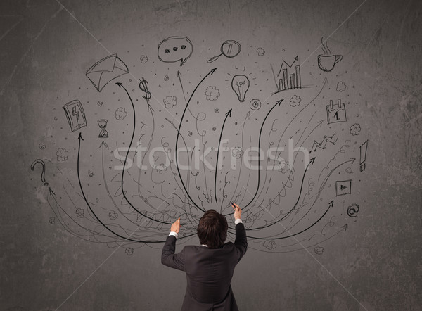 Businessman in front of a chalkboard deciding with arrows and si Stock photo © ra2studio