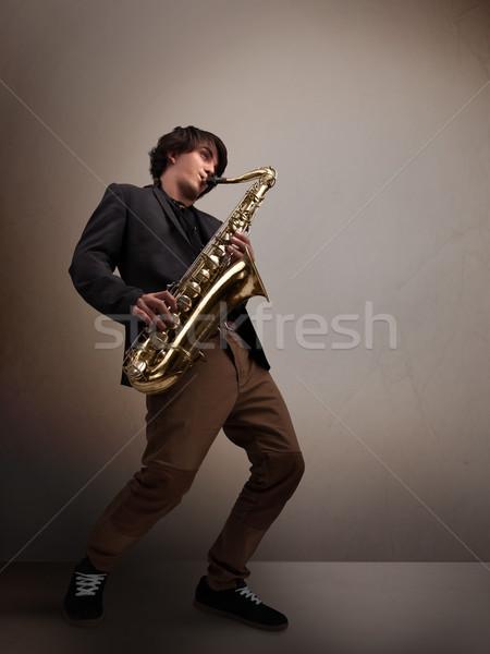 Fiatal zenész játszik szaxofon jóképű zene Stock fotó © ra2studio